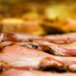 Why does bacon sometimes have greenish colour?