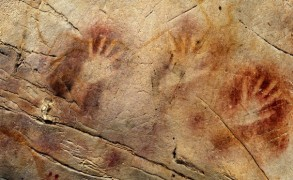 The Panel of Hands, El Castillo Cave, Spain. A hand stencil has been dated to earlier than 37,000 years ago and a red disk to earlier than 40,600 years ago, making them the oldest cave paintings in Europe. Image: Pedro Saura