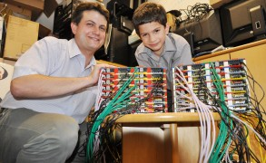 Professor Simon Cox and his Lego-expert son, James, with the Iridis-Pi supercomputer made from Raspberry Pi and Lego. Image: Simon Cox