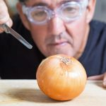 Why do our eyes water when we chop up onions?